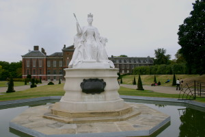 Queen Victoria in front of Kensington Palace where Princess Diana lived